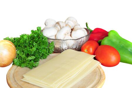 Ingredients for lasagna - tomatoes, pepper, parsley, mushrooms, onion, pasta on white background Stock Photo - 12131212