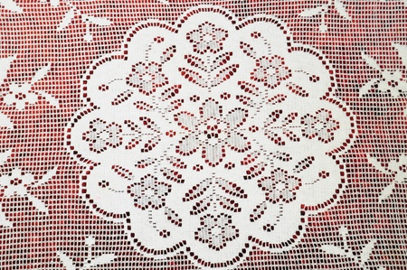 White handknitted lace over red velvet Stock Photo - 12131434