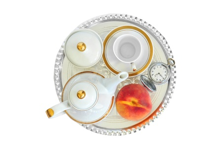 Coffee set, appricot and pocket watch, arranged for breakfast on sliver tray