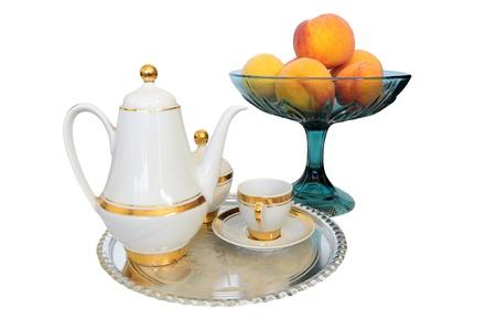 Breakfast set - coffee set, bowl of appricots photo