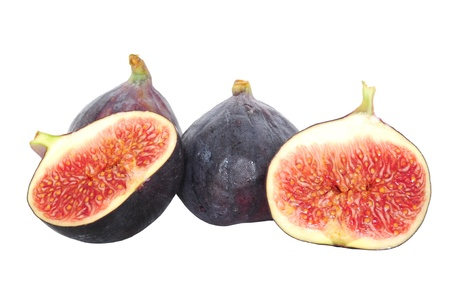 Fresh cut fig halves and whole fruit isolated on white
