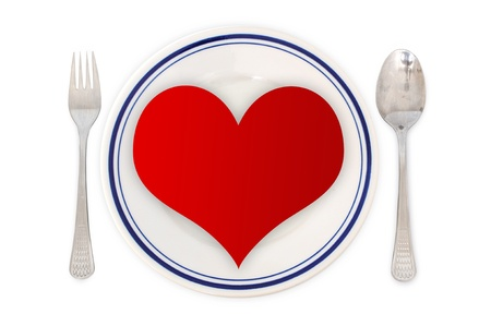 Concept of love - arrangement for dinner with heart shapes in the plate photo