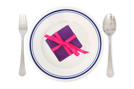 Concept of love - arrangement for dinner with gift on the plate photo