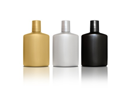 Set of three bottles of cosmetic products for men - silver, gold, black photo