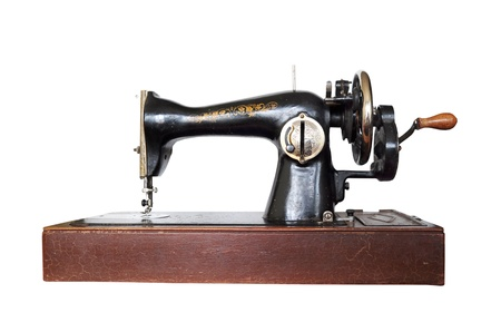 Vintage sewing machine on white background photo