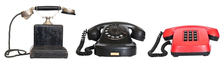 decades: Three vintage telephones from different decades isolated on white Stock Photo