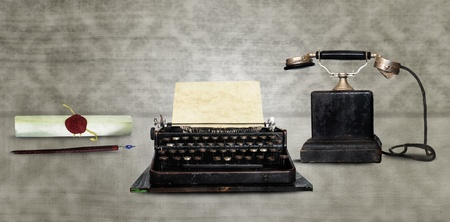 old phone: Retro communication tools - Dip pen, typewriter and vintage phone Stock Photo