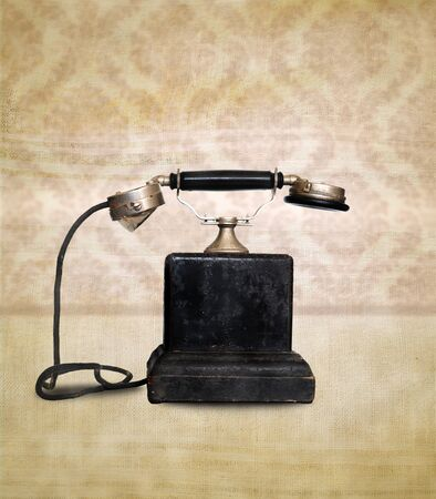 Vintage telephone on retro background