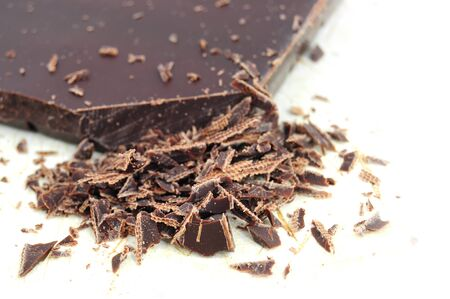 Extreme closeup of chopped chocolate pieces, isolated Stock Photo - 12355875