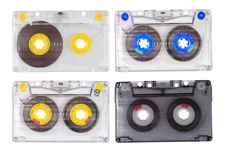 Four old tape cassettes isolated on white photo
