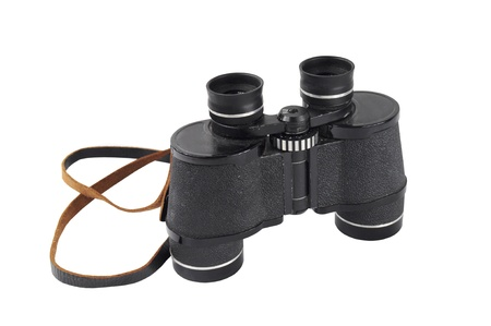 Pair of old black binoculars isolated on white