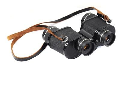 Pair of black binoculars isolated on white photo