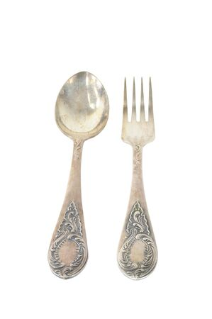 Vintage silver fork and spoon with ornaments isolated on white background photo