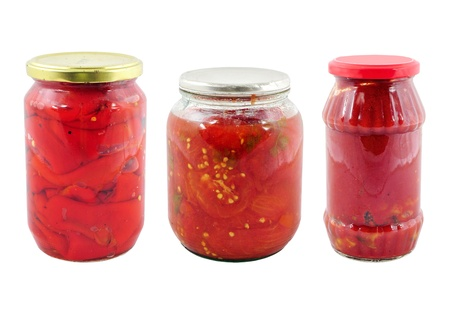 food preservation: Food preservation. Jars with preserved tomatoes and peppers Stock Photo