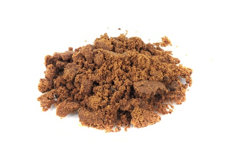 Closeup of pile of brown sugar isolated on white