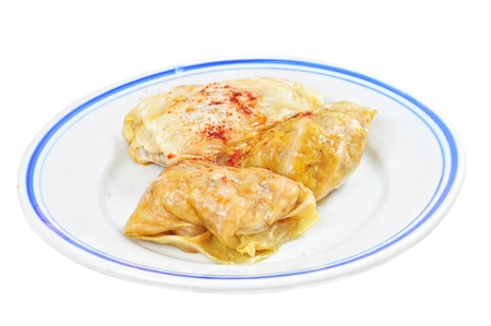 Traditional lenten dish from the Balkans - cabbage rolls with rise  sarma , isolated on white Standard-Bild