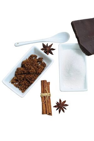 Sweet ingredients - white and brown sugar, chocolate, cinnamon and anise, isolated on white Stock Photo - 12677255