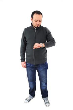 young man waiting, checking his watch