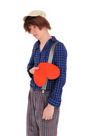 heartbroken: Sad heartbroken nerdy guy, holding heart Stock Photo