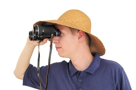 Young caucasian man with straw hat and binoculars Stock Photo