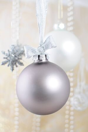 Christmas decoration - silver bauble on ribbon Stock Photo