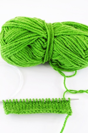Green and yarn and needles and piece of knitting Stock Photo - 17451789
