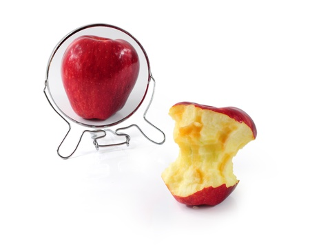 Fat and slim apple in mirror - metaphor for eating disorder