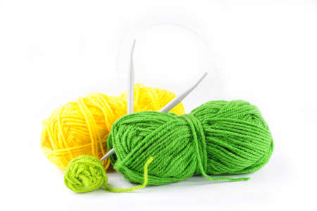 Green and yellow yarn and needles for knitting Stock Photo - 17451768