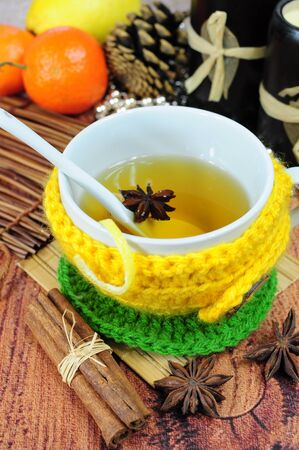 Herbal tea in cup wrapped in knitted sleeve