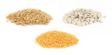 Pile of uncooked lentils, white beans and red lentils isolated on white Standard-Bild
