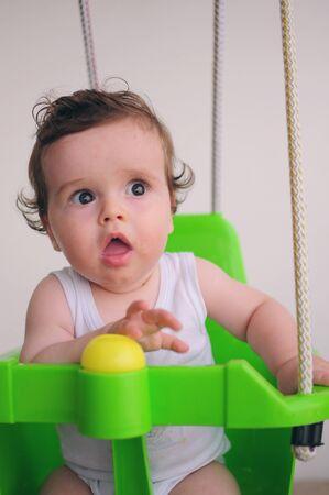 Baby on a swing Standard-Bild