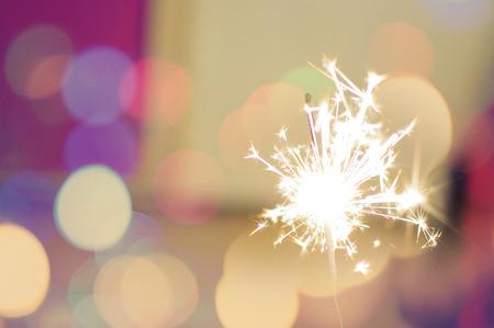Sparkle stick on holiday background