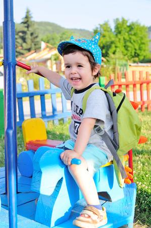 Little kid on a roundabout, enjoying the ride Standard-Bild