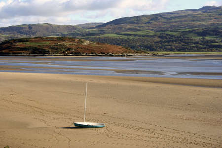 Stranded boat on sand Stock Photo