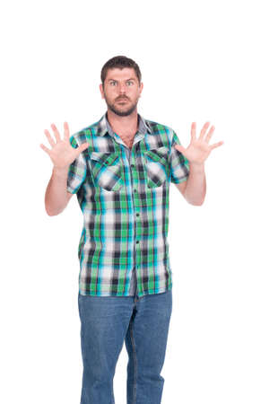 Deaf or hearing impaired man with in chequered shirt making signs with his hands Stock Photo - 26305577