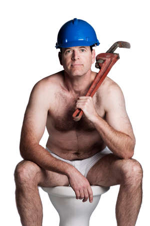 male with helmet and wrench sitting on a toilet