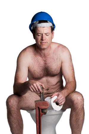 male with helmet and wrench sitting on a toilet photo