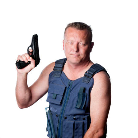 bullet proof: caucasian male with gun and vest