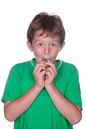 marshmellow: Young child in green short eating chocolate marshmellow eggs  Stock Photo