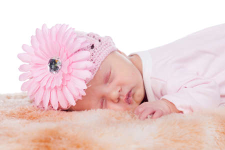 beautiful female newborn baby in pink sleeping photo