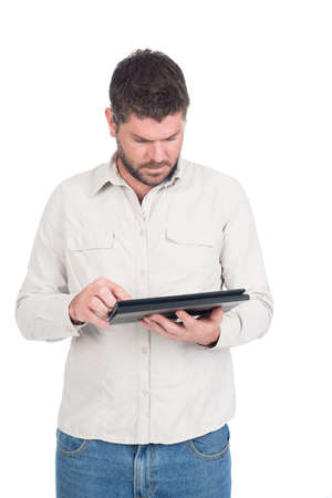 Deaf or hearing impaired man with tablet in cream shirt Stock Photo - 26304744