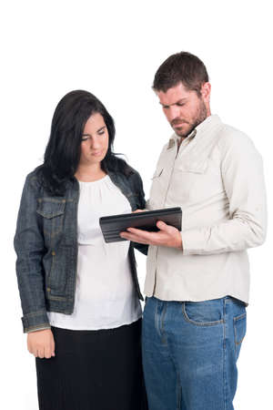 young deaf or hearing impaired couple or siblings using a tablet  Stock Photo - 26304745