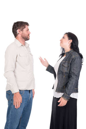 young deaf or hearing impaired couple or siblings using signs language to communicate photo