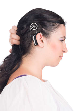 impaired: young deaf or hearing impaired woman showing her cochlear implant