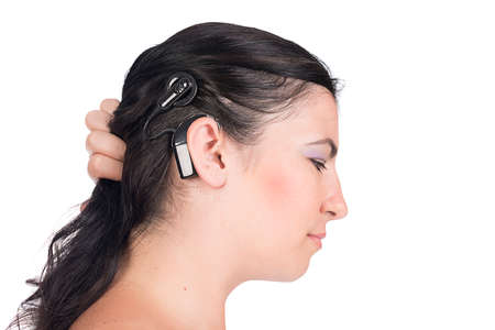 young deaf or hearing impaired woman showing her cochlear implant  photo