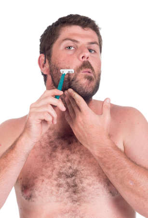 young man shaving with a razor blade photo