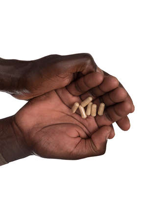 two African black hands holding pain pills  photo