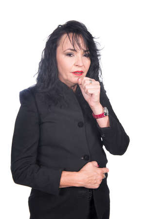 adult caucasian woman in black clothes and jacket with red lips and mails coughing with hand in front of her mouth photo