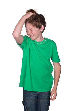red head: young boy scratching his head Stock Photo