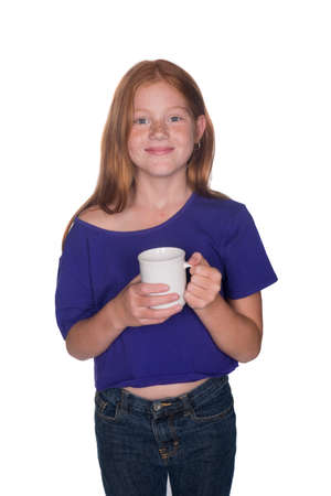 red head girl: young red head girl in purple shirt with white cup